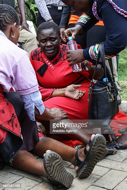 Kenyan woman reacts in front of morgue of Chiromo Campus of Nairobi University on April 04 2015 after she identified the corps of his relatives...