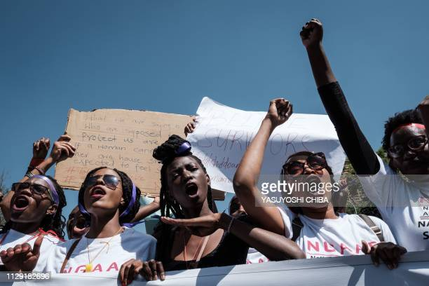 Kenyan women shout slogans as they participate in a feminist march held to call a halt to the nation's femicide in Nairobi on March 8 on...