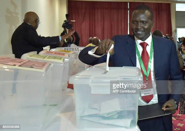 Kenyan world marathon champion Paul Tergat casts his ballot for the elections of the president of the National Olympic Committee of Kenya in Nairobi...