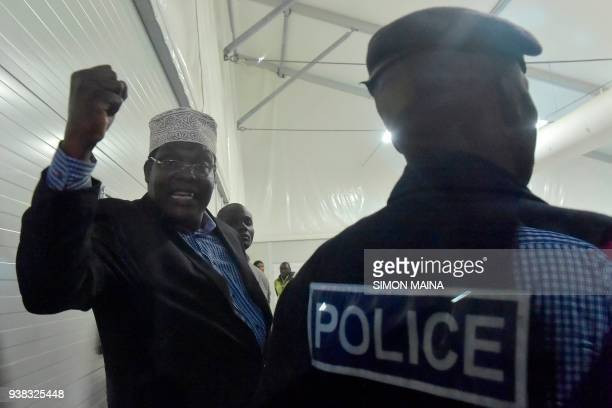 Kenyanborn Canadian lawyer and selfdeclared National Resistance Movement General Miguna Miguna gestures as after being detained by Kenyan police at...