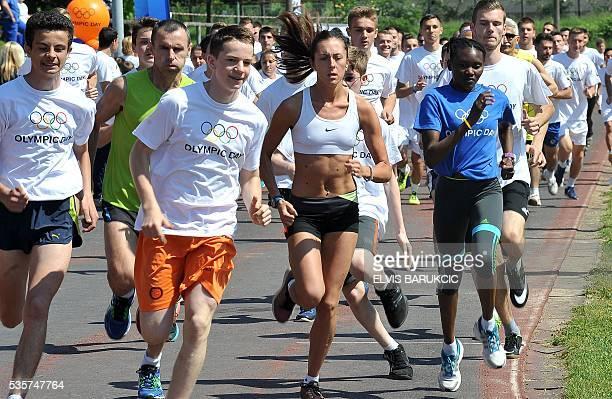 Kenyanborn marathon runner with Bosnia and Herzegovina citizenship Lucia Kimani runs a mass race with other members of the Bosnian Olympic team...