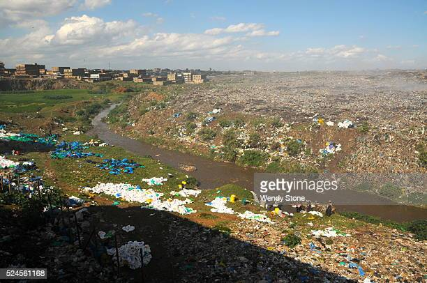 Kenyans collecting used plastic bags from Nairobi River to resell in marketplaces near Mukuru slum in Kenya Dirty plastic bags are recycled as a...