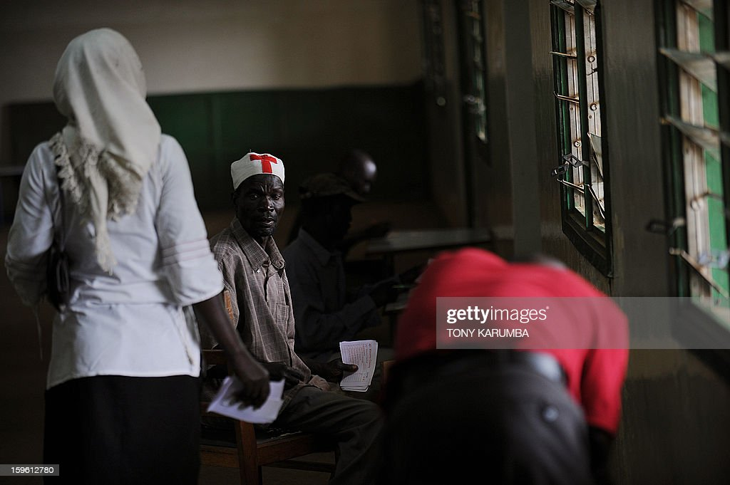 Kenyans fill out ballots bearing the names of candidates as they vote in political party primary nominations on January 17, 2013, in the lakeside town of Kisumu, ahead of this year's general election to be held in March. The March 2013 elections are the first since the bloody 2007-08 polls that left at least 1,100 killed and 600,000 more displaced after what began as protests over the election results degenerated into vicious killings pitting supporters of Prime Minister Raila Odinga against those of the outgoing president Mwai Kibaki. AFP PHOTO / Tony KARUMBA