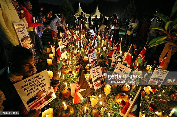 Kenyans hold a candlelit vigil in honour of Kenya Defence Force soldiers on January 21 2016 in Nairobi Large numbers of KDF soldiers were killed...