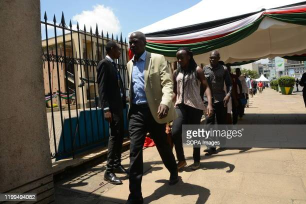 Kenyans make their way into the parliament building to see the body of the late former President of Kenya Daniel Arap Moi in Nairobi Kenya The former...