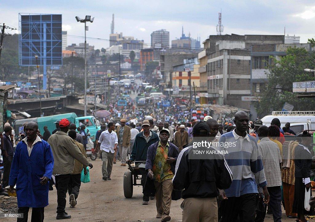 Kenyans throng a street in a Nairobi sub : News Photo