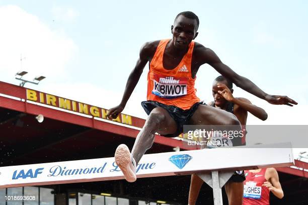Kenya's Abraham Kibiwot takes the jump during the men's 3000m steeplechase during the 2018 IAAF Birmingham Diamond League athletics meeting at...