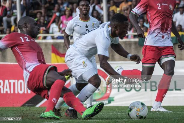 Kenya's Achieng Joash Onyango vies for the ball with Ghana's Majeed Waris during the 2019 Africa Cup of Nations qualifier match between Kenya and...