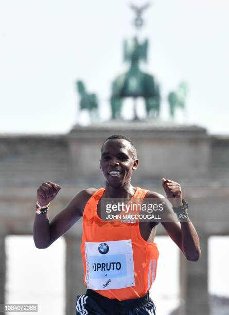 Kenya's Amos Kipruto crosses the finish line to place second at the Berlin Marathon on September 16 2018 in Berlin