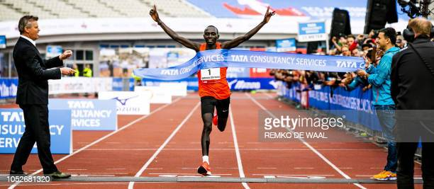 Kenya's athlete Lawrence Cherono celebrates winning the TCS Amsterdam Marathon 2018 in Amsterdam, The Netherlands on October 21, 2018. / Netherlands...