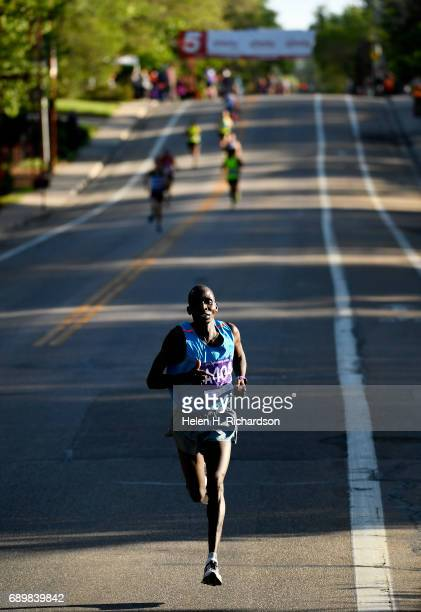 Kenya's Barnabas Kosgei, A404, creates an unsurmountable lead over the rest of the pack during the citizen's race of the 39th annual Bolder Boulder...