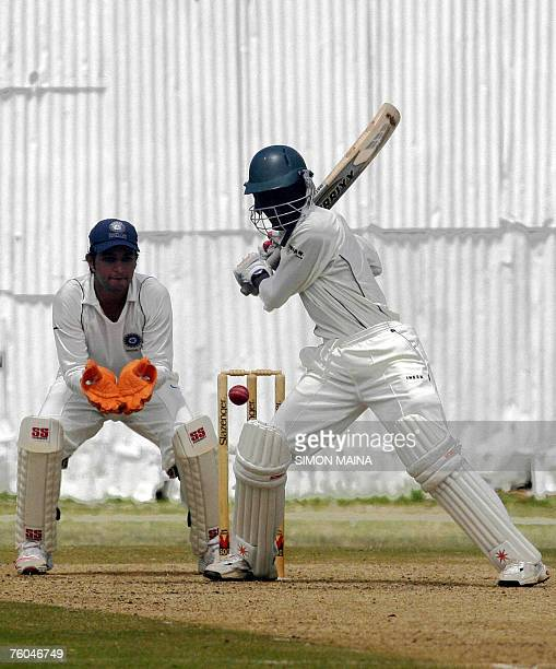 Kenya's batsman Alex Obanda hits against India A bowler Pragyan Ojha as wicketkeeper Mahesh Rawat waits for the catch 10 August 2007 during their...