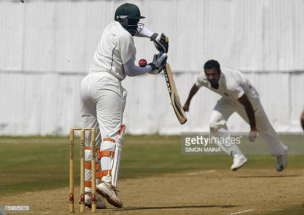 Kenya's batsman David Obuya misses the ball from India's bowler Irfan Parthan 05 August 2007 during a threeday match at the Mombasa sports club Obuya...
