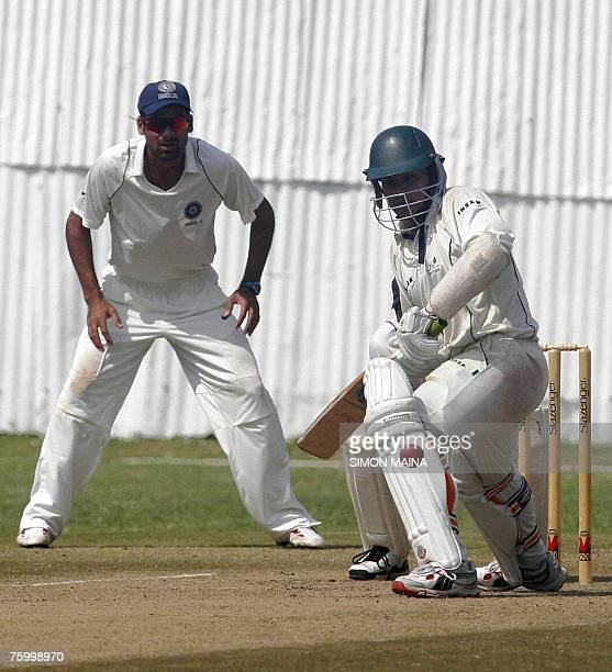Kenya's batsman Hiren Viraiya plays a shot as India's Mohamed Kaif watches 07 August 2007 during their three day match at the Mombasa Sports Club...