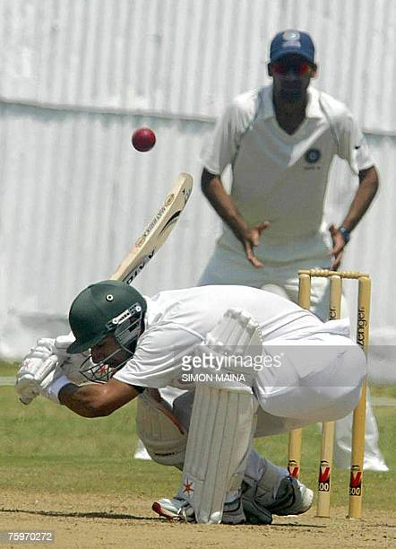 Kenya's batsman Rajesh Budhia ducks the ball before being stumped by India's bowler Piyush Chawla 05 August 2007 during a three day match at the...