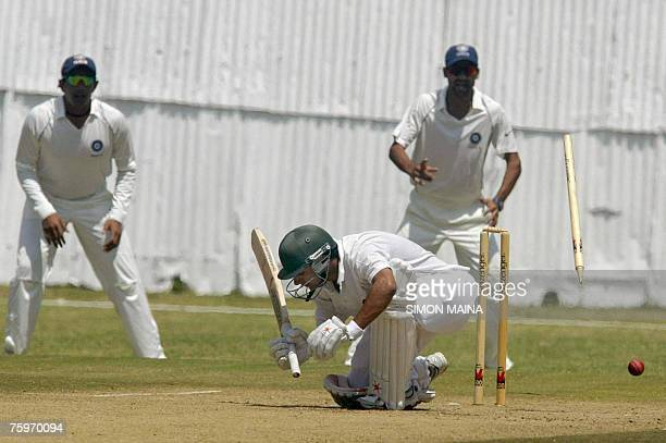Kenya's batsman Rajesh Budhia is dismissed as stumps and bails fly by India's bowler Piyush Chawla 05 August 2007 during a three day match at the...