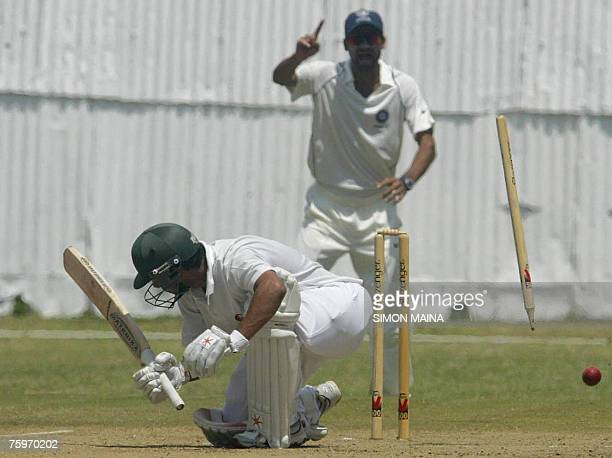 Kenya's batsman Rajesh Budhia is dismissed as stumps and bails fly by India's bowler Piyush Chawla 05 August 2007 during a threeday match at the...