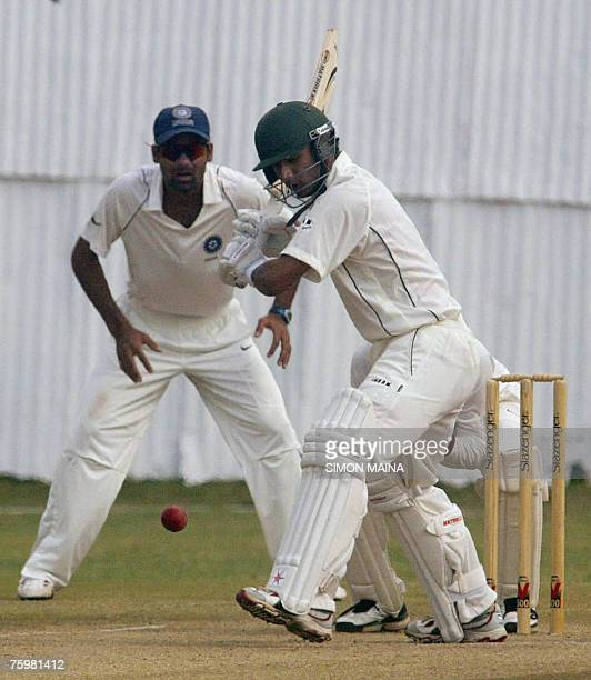 Kenya's batsman Tanmay Mishra hits out against India's as wicket keeper Mohamed Kaif looks on 06 August 2007 during a threeday match at the Mombasa...