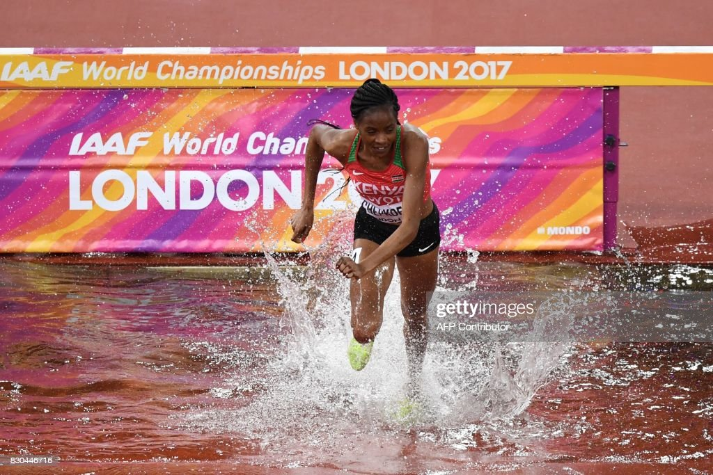 Kenya's Beatrice Chepkoech competes after taking the wrong turn in the final of the women's 3000m steeplechase athletics event at the 2017 IAAF World Championships at the London Stadium in London on August 11, 2017. /