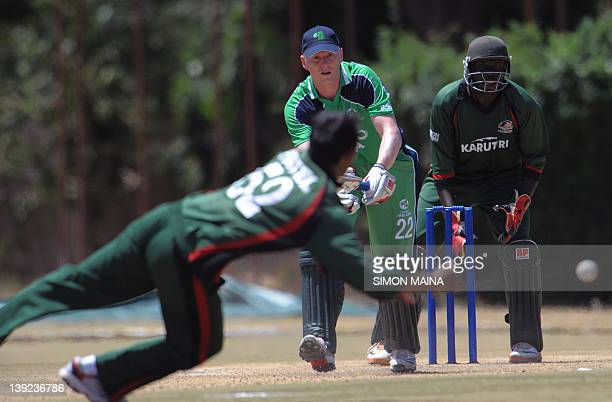 Kenya's bowler Rakep Patel tries to catch the ball from Ireland's batsman Kelvin Obrien as wicket keeper David Obuya look on during the oneday...