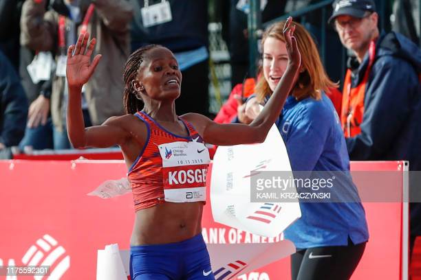 Kenya's Brigid Kosgei crosses the finish line as she wins the women's 2019 Bank of America Chicago Marathon with the World Record on October 13 2019...