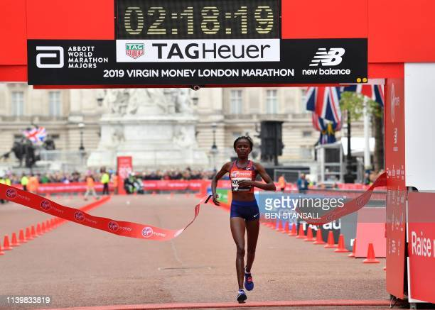 TOPSHOT Kenya's Brigid Kosgei crosses the finish line to win the elite women's race of the 2019 London Marathon in central London on April 28 2019 /...