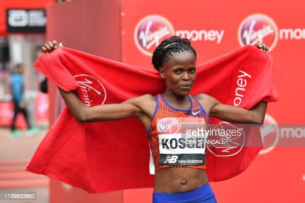 TOPSHOT Kenya's Brigid Kosgei poses for a photograph after winning the elite women's race of the 2019 London Marathon in central London on April 28...
