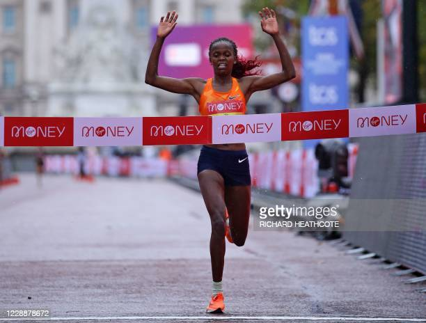 Kenya's Brigid Kosgei runs to the finish line to win the women's race of the 2020 London Marathon in central London on October 4, 2020. - This year's...