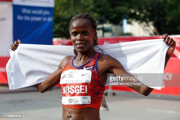 Kenya's Brigid Kosgei smiles after winning the women's 2019 Bank of America Chicago Marathon with the World Record on October 13 2019 in Chicago...