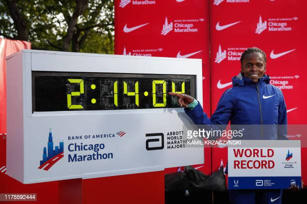 TOPSHOT Kenya's Brigid Kosgei smiles after winning the women's 2019 Bank of America Chicago Marathon with the World Record on October 13 2019 in...