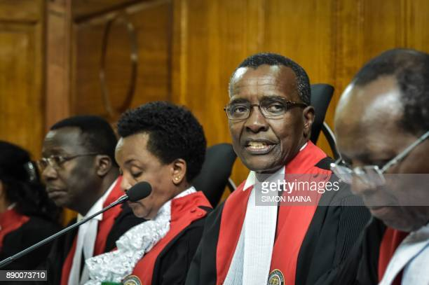 Kenya's Chief Judge David Maraga reacts at The Supreme Court in Nairobi on December 11 before all judges delivered their full judgement on the...