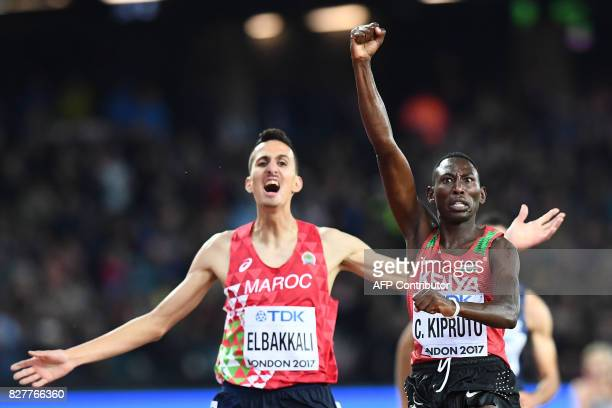 TOPSHOT Kenya's Conseslus Kipruto celebrates as he beats Morocco's Soufiane Elbakkali to the finish in the final of the men's 3000m steeplechase...