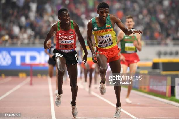 Kenya's Conseslus Kipruto crosses the finsh line and wins next to second-placed Ethiopia's Lamecha Girma in the Men's 3000m Steeplechase final at the...