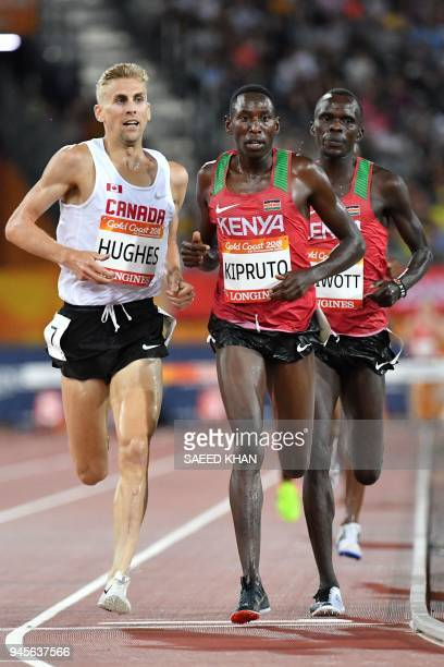 Kenya's Conseslus Kipruto , Kenya's Abraham Kibiwott and Canada's Matthew Hughes compete during the athletics men's 3000m steeplechase final during...