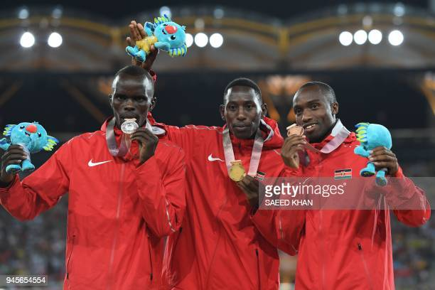 Kenya's Conseslus Kipruto Kenya's Abraham Kibiwott and Kenya's Amos Kirui pose with their medals after the athletics men's 3000m steeplechase final...