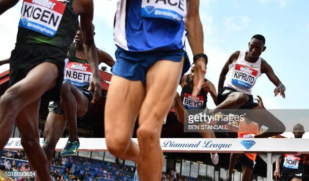 Kenya's Conseslus Kipruto takes the jump during the men's 3000m steeplechase during the 2018 IAAF Birmingham Diamond League athletics meeting at...