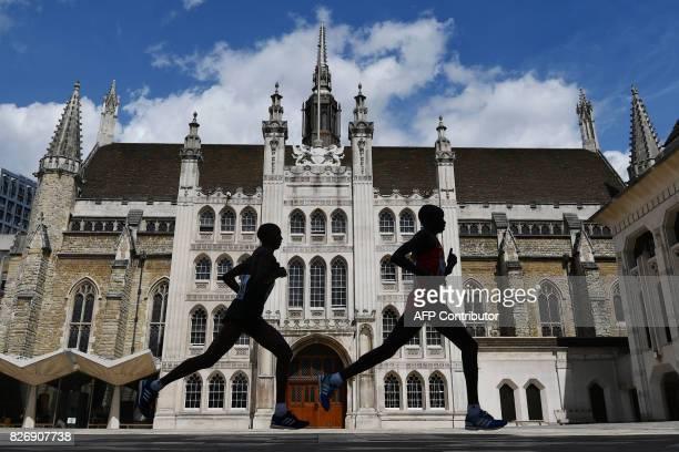 TOPSHOT Kenya's Daniel Kinyua Wanjiru runs through the Guildhall during the men's marathon athletics event at the 2017 IAAF World Championships in...
