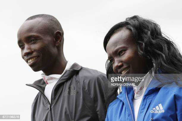 Kenya's Daniel Wanjiru and Mary Keitany pose during a photocall beside Tower Bridge the day after winning the men's and women's elite races at the...