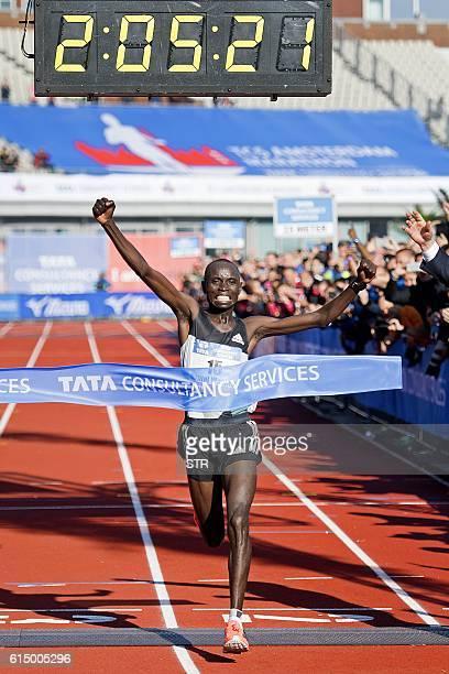 Kenya's Daniel Wanjiru celebrates as he crosses the finish line to win the Amsterdam Marathon in Amsterdam on October 16 2016 / AFP / ANP / STR /...