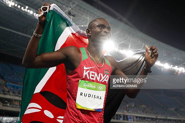 TOPSHOT Kenya's David Lekuta Rudisha celebrates after winning the Men's 800m Final during the athletics competition at the Rio 2016 Olympic Games at...