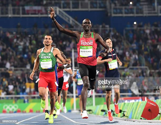 Kenya's David Lekuta Rudisha celebrates as he crosses the finish line to win the Men's 800m Final during the athletics event at the Rio 2016 Olympic...