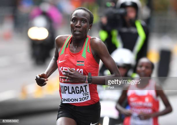 Kenya's Edna Ngeringwony Kiplagat leads Bahrain's Rose Chelimo in the Women's Marathon during day three of the 16th IAAF World Athletics...