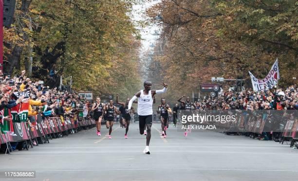 Kenya's Eliud Kipchoge celebrates after busting the mythical twohour barrier for the marathon on October 12 2019 in Vienna Kenya's Eliud Kipchoge on...