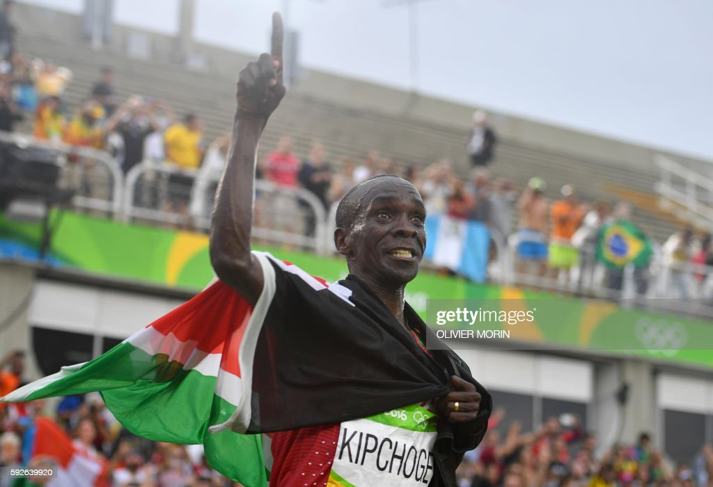 TOPSHOT - Kenya's Eliud Kipchoge celebrates after winning the Men's Marathon athletics event of the Rio 2016 Olympic Games at the Sambodromo in Rio de Janeiro on August 21, 2016. /