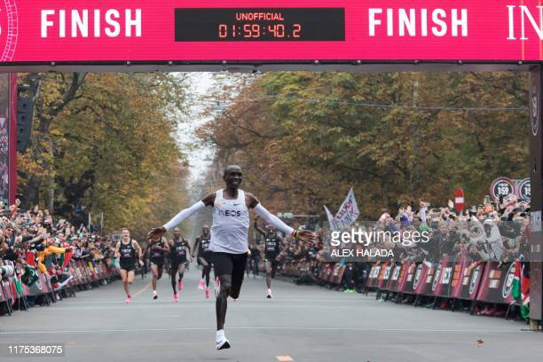 TOPSHOT Kenya's Eliud Kipchoge celebrates as he crosses the finish line at the end of his attempt to bust the mythical twohour barrier for the...