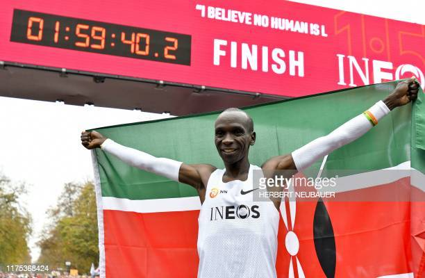 Kenya's Eliud Kipchoge celebrates in the finish area of a special course after busting the mythical twohour barrier for the marathon on October 12...