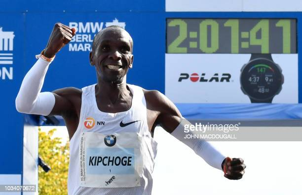 TOPSHOT Kenya's Eliud Kipchoge celebrates winning the Berlin Marathon setting a new world record on September 16 2018 in Berlin