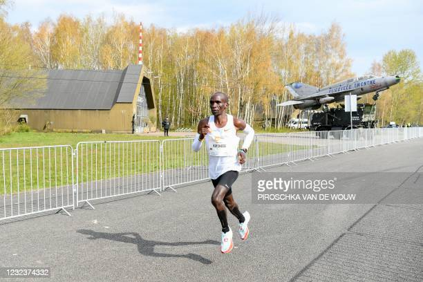 """Kenya's Eliud Kipchoge competes to win the """"Hamburg Marathon"""" taking place at the Twente airport in Enschede, the Netherlands on April 18, 2021 as..."""