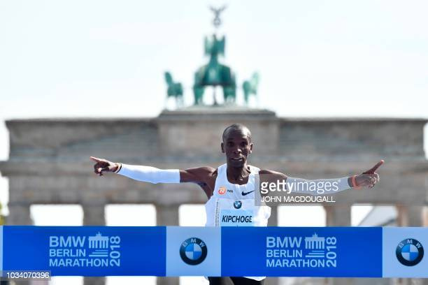TOPSHOT Kenya's Eliud Kipchoge crosses the finish line to win the Berlin Marathon setting a new world record on September 16 2018 in Berlin