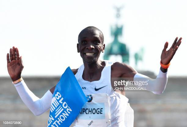 Kenya's Eliud Kipchoge crosses the finish line to win the Berlin Marathon setting a new world record with 2h0139 on September 16 2018 in Berlin